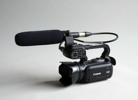 Photo of the Canon XA10 on a grey background.