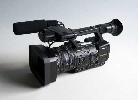 Photograph of a Sony NX5U video camera on a grey gradient background.
