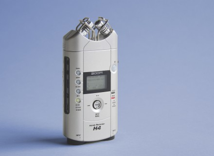 Image of Zoom H4 audio recorder standing upright on a blue background
