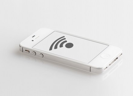 White iphone with WIFI logo displayed on the screen