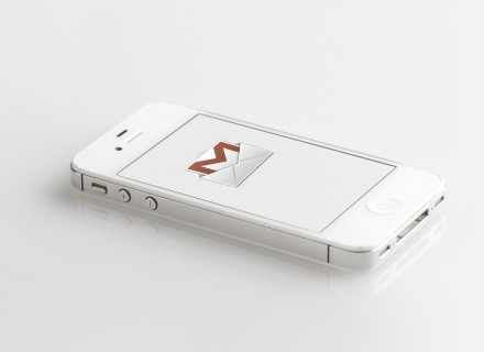 image of white iPhone on white background with gryphmail logo on the screen.
