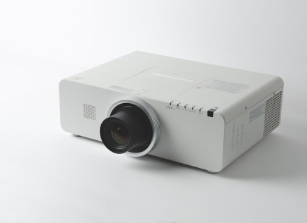 Photo of a projector sitting on a white surface
