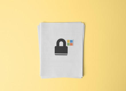 Photo of white printer paper with an image of a lock and windows icon on the page.