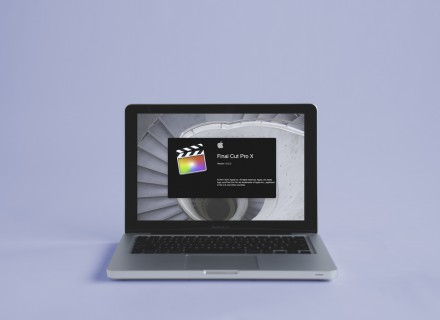Photography of a Macbook Pro with the Final Cut Pro X launch screen visible